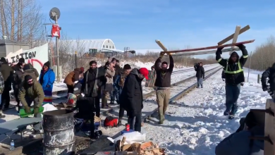 Photo of WATCH: Frustrated locals tear down anti-pipeline blockade and load it into truck