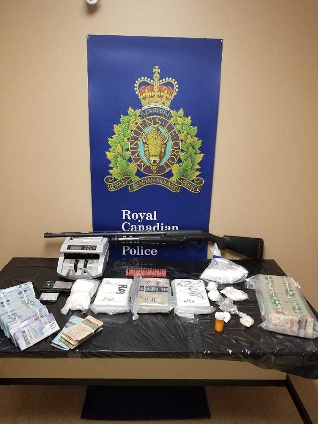 """Grand Falls-Windsor RCMP seizes large quantity of cocaine, cash, a firearm and a vehicle; two men arrested; """"cocaine would be valued at approximately $840,000.00"""""""