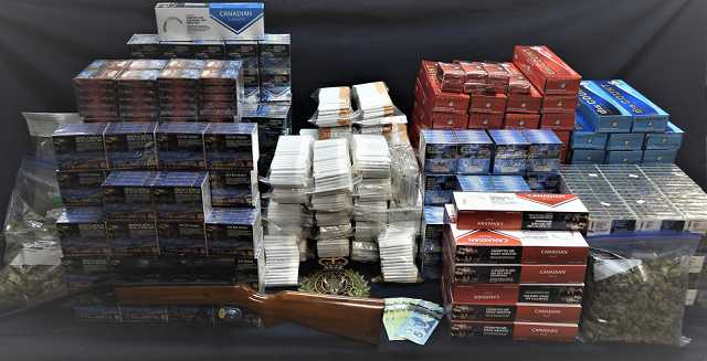 Police seized a substantial amount of illegal cannabis, contraband cigarettes, and an air rifle. Police also seized money, and drug paraphernalia.