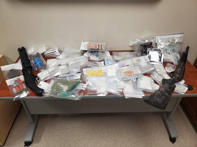 Swan River RCMP recover firearms, drugs and cash during search